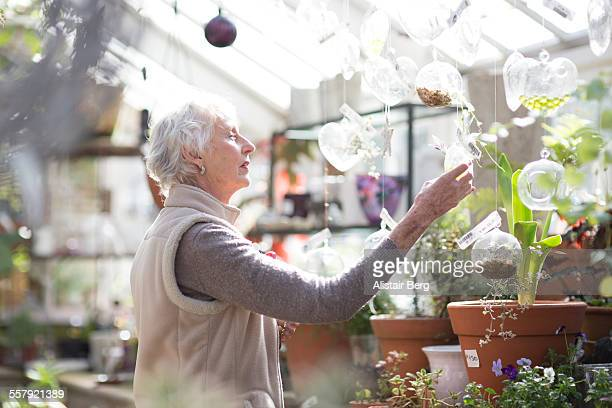 Senior woman in greenhouse