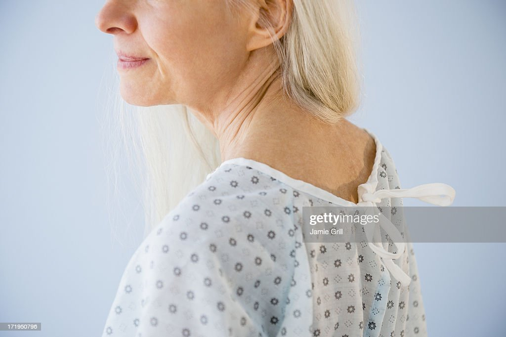 Senior woman in hospital gown