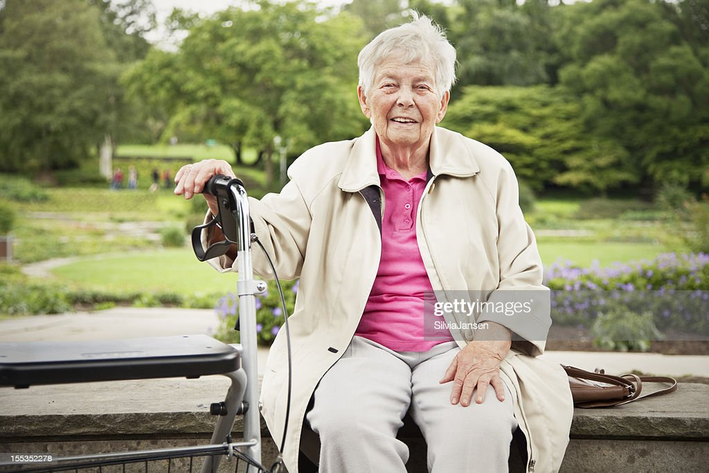 senior woman in park with walker