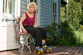 Senior woman in roller skates