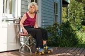 Senior woman in roller skates