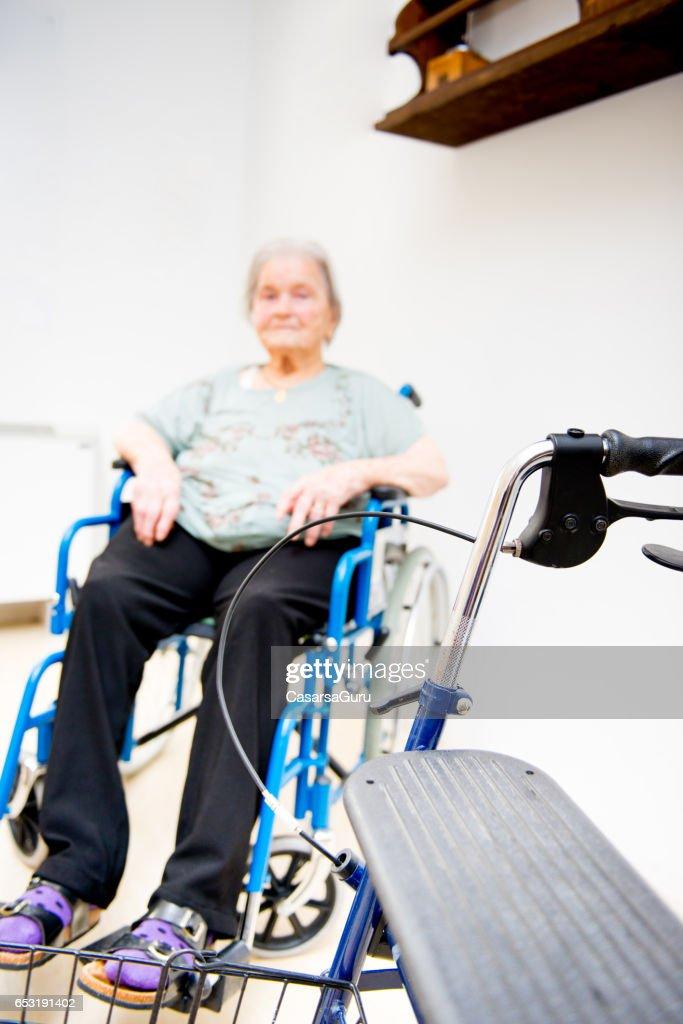 Senior Woman In The Nursing Home Waiting On  Wheelchair : Stock Photo
