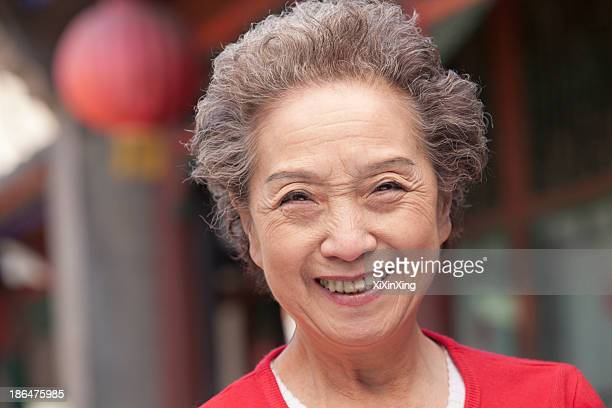 Senior Woman in Traditional Chinese Courtyard