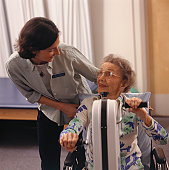 Senior woman in wheelchair having physical therapy