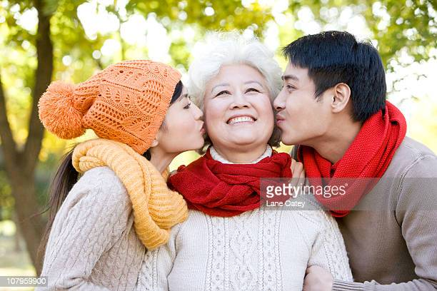 Senior Woman Kissed on Both Cheeks
