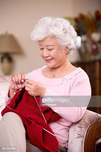 Senior Woman Knitting a Sweater