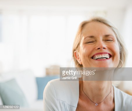 Senior woman laughing, close up : Stock Photo