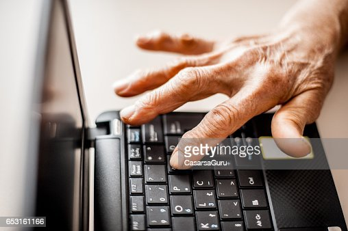 Senior Woman Learning To Use Computer : Stock Photo