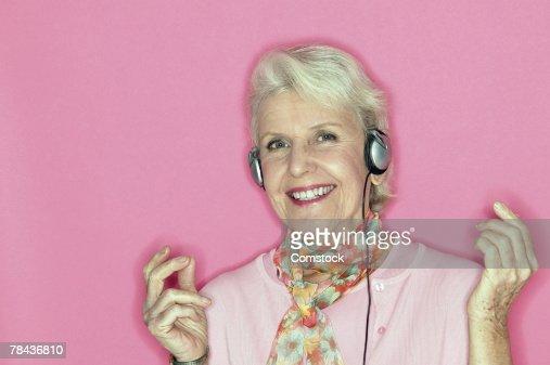 Senior woman listening to music on headphones