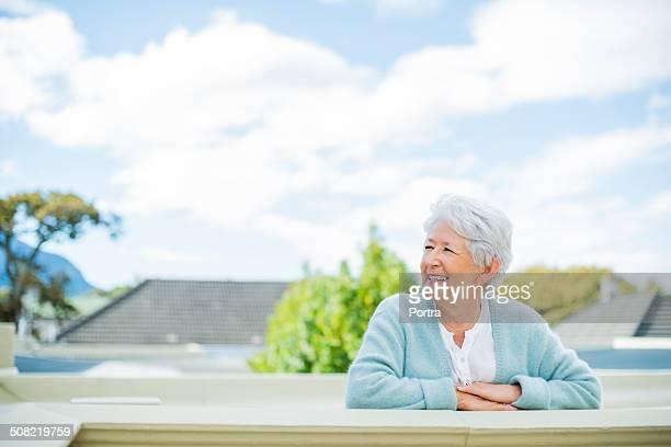 Senior woman looking away on terrace