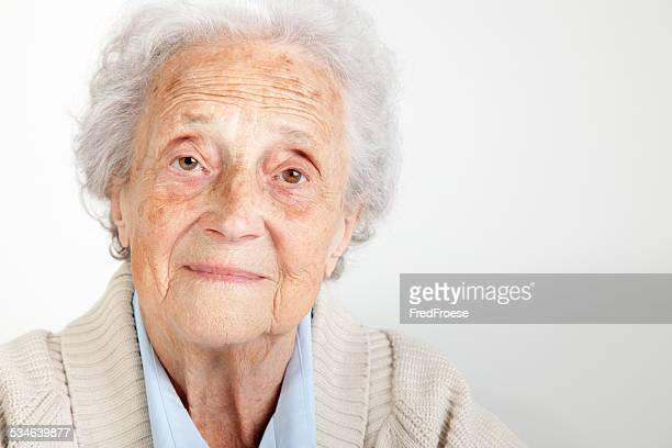 Senior woman looking into camera