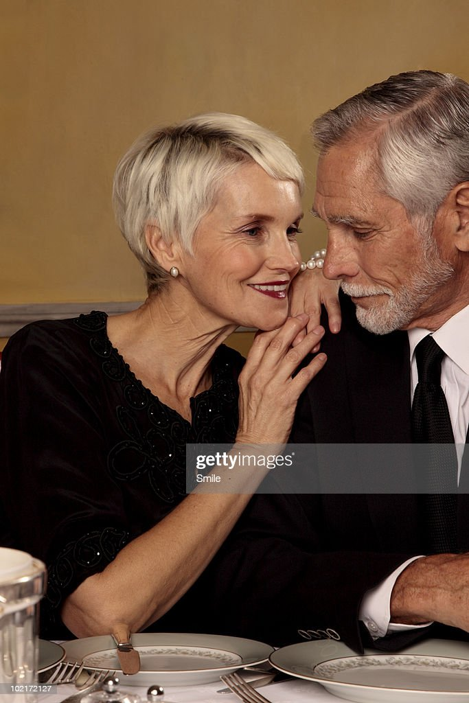 Senior woman looking lovingly at her man : Stock Photo