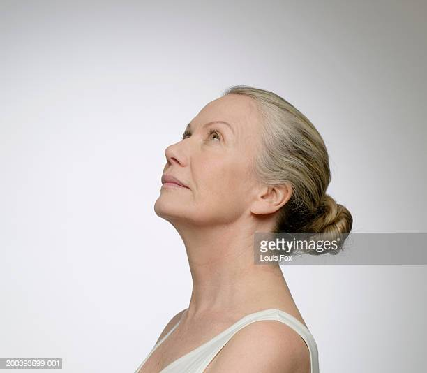 Senior woman looking up, side view