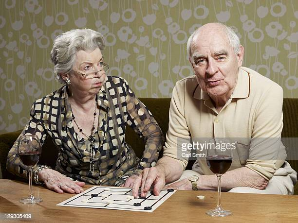 Senior woman looks shocked by man's muehle tactics