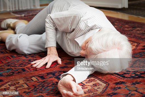 senior woman lying on the floor after accident