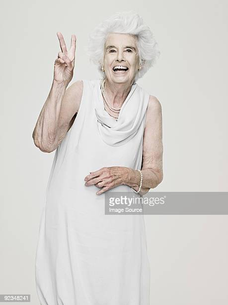 Senior woman making a peace sign