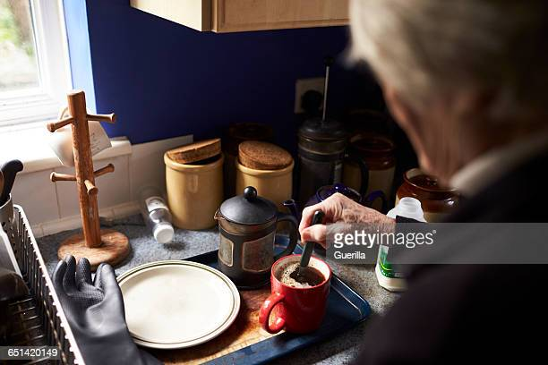 Senior Woman Making Hot Drink In Kitchen