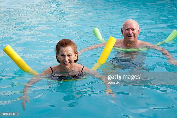 Senior Woman & Man in Swimming Pool