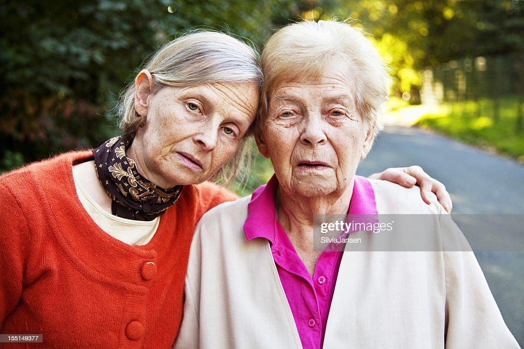 senior woman  mature daughter sadness