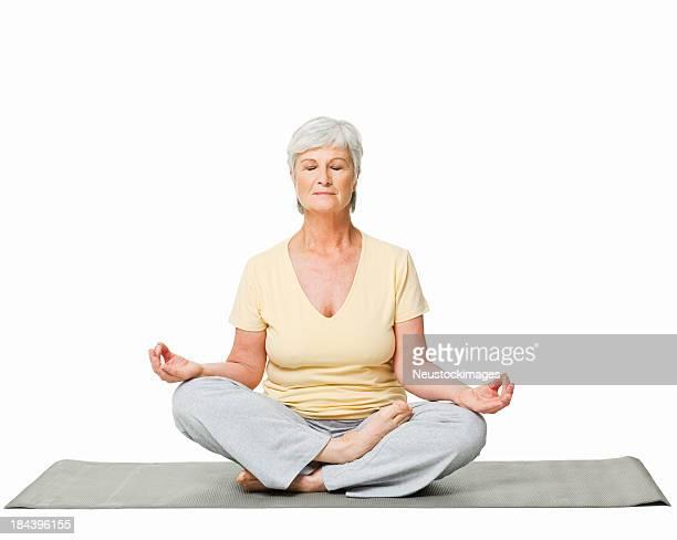 Senior Woman Meditating - Isolated