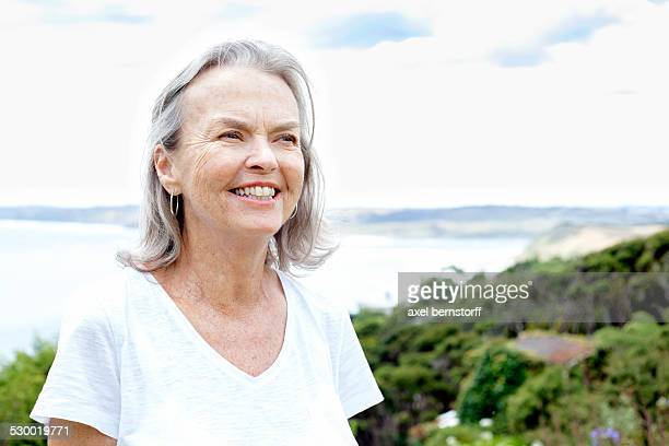 Senior woman, ocean in background, Raglan, New Zealand
