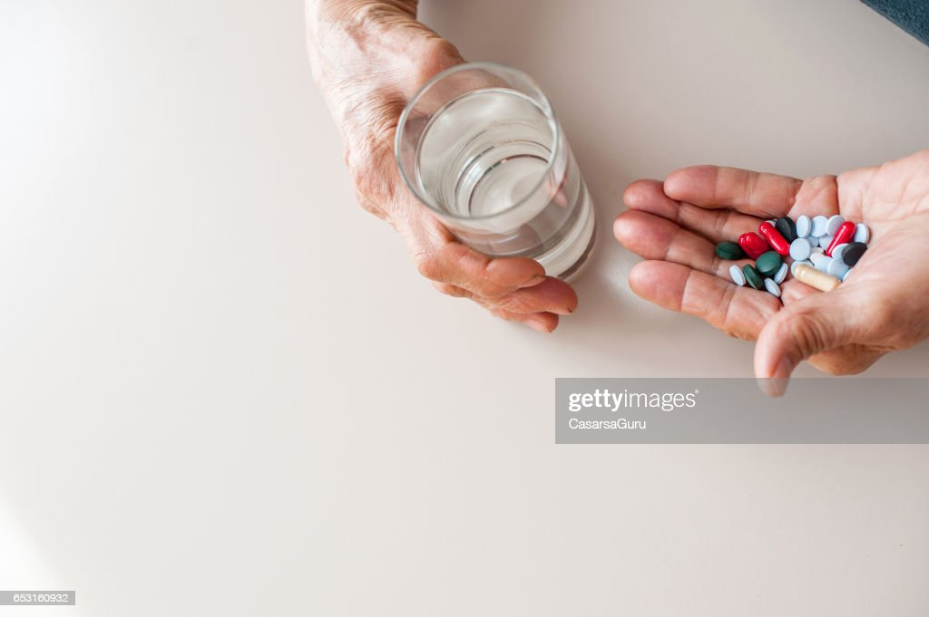 Senior Woman Old Hands Taking Medicine : Stock Photo