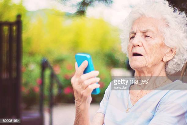 Senior Woman on Cell Phone Video Call, Surprised