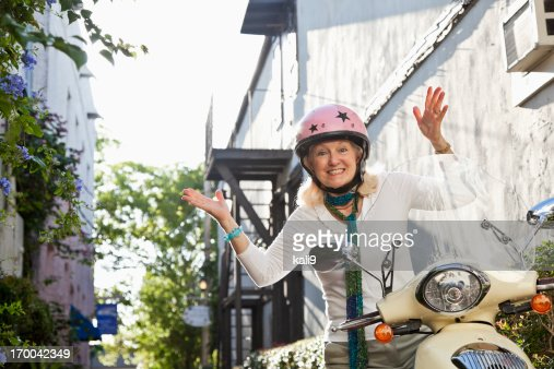 Senior woman on motor scooter