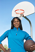 Senior woman on outdoor basketball court, portrait