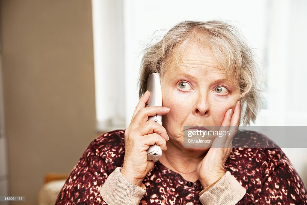 senior woman on the phone worried