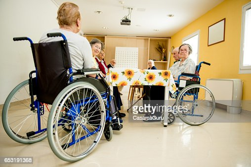 Senior Woman On Wheelchair Waiting In The Dining Room : Stock-Foto