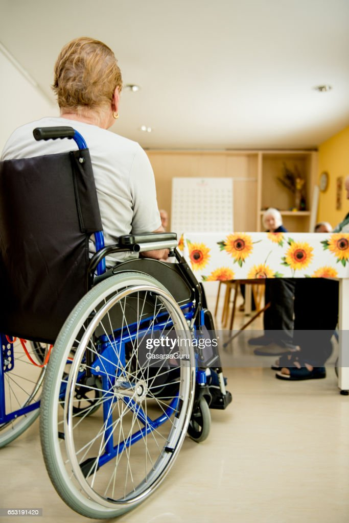 Senior Woman On Wheelchair Waiting In The Dining Room : Bildbanksbilder