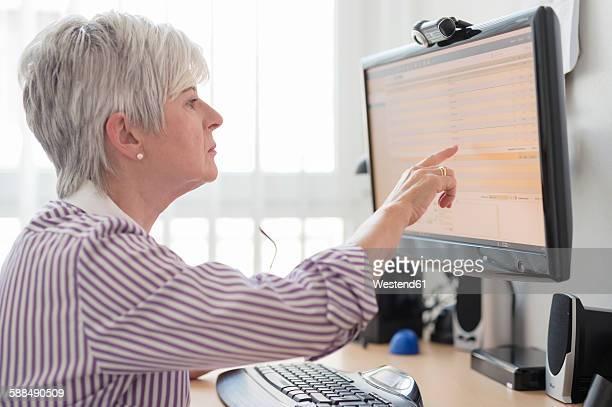 Senior woman online banking