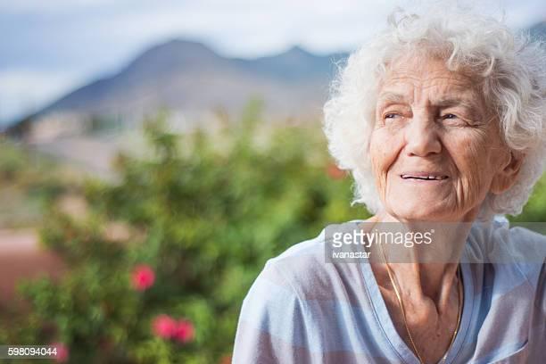 Senior Woman Outdoors, Pensive