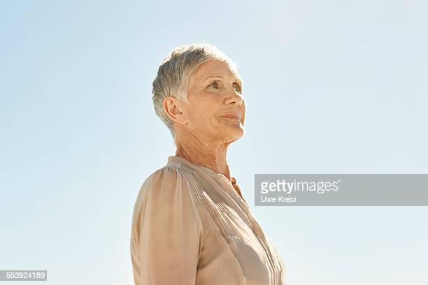 Senior woman outdoors, portrait