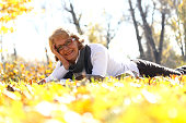 Only senior woman-Cheerful woman enjoying in park, she smiling and looking at camera