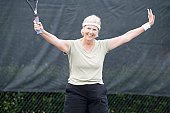 Senior woman playing tennis