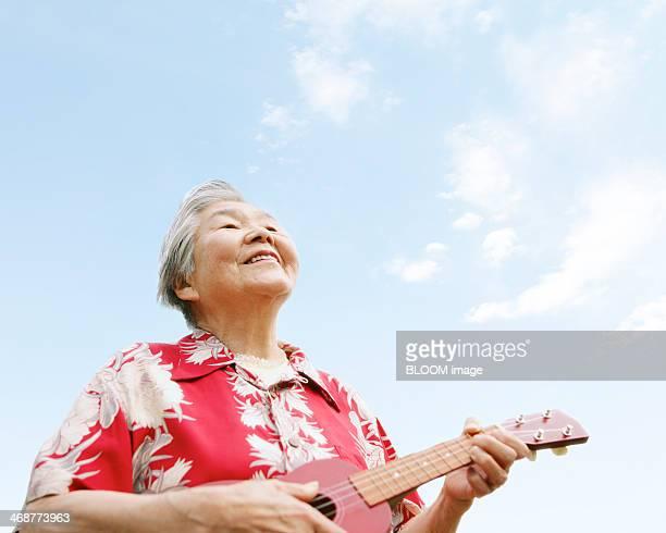 Senior Woman Playing Ukulele