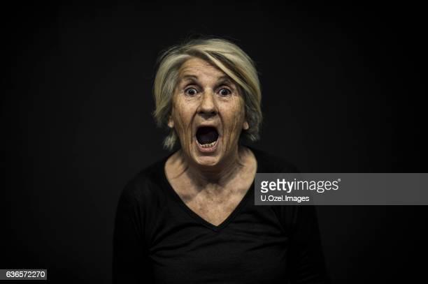 Senior Woman Portrait Front of a Black Background