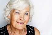 Beautiful senior woman portrait, outdoor on grey background