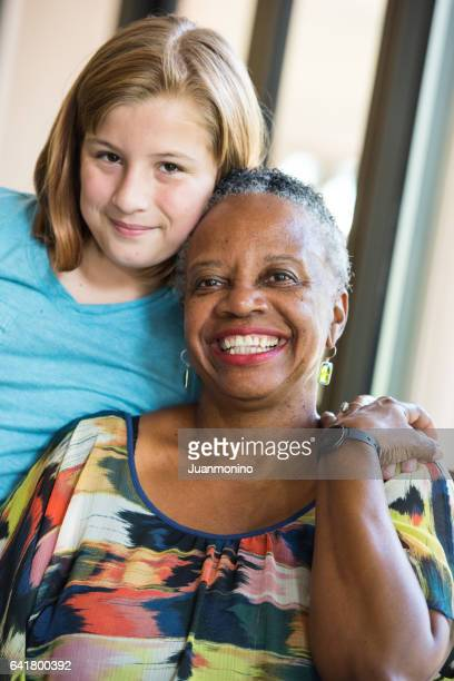 Senior woman posing with her granddaughter or student