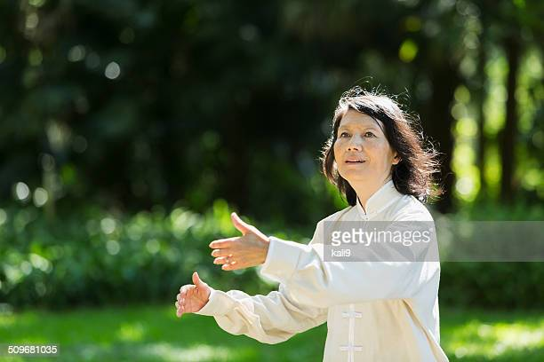 Senior woman practicing tai chi
