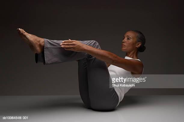 Senior woman practising yoga
