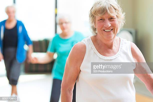Senior woman prepares to line dance at senior center