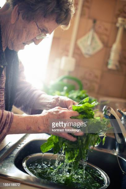 Senior woman preparing a meal