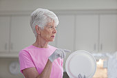 Senior woman preparing for a luncheon