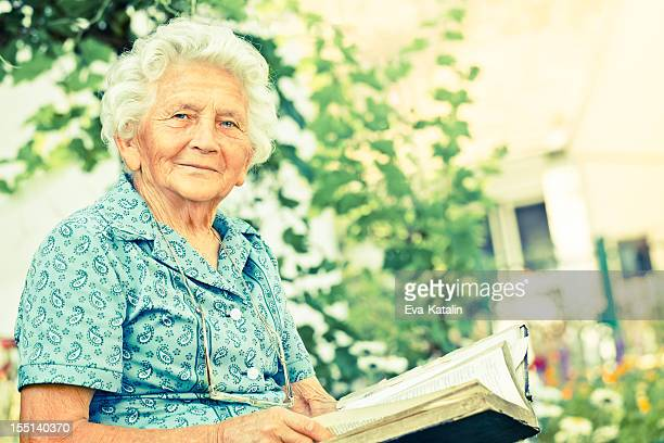 Senior woman reading a Holy Bible