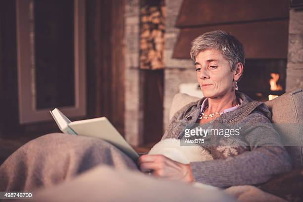Senior Woman Reading on Sofa