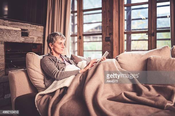 Senior Woman Reading on Sofa
