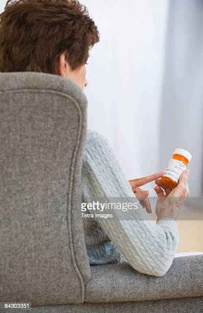 Senior woman reading prescription label